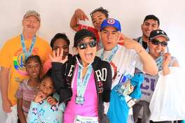 Bay to Breakers 2017 runners pose for pictures at the SFGATE finish line booth on Sunday, May 21, 2017. Photo booth images courtesy of Kande Photo Booths.