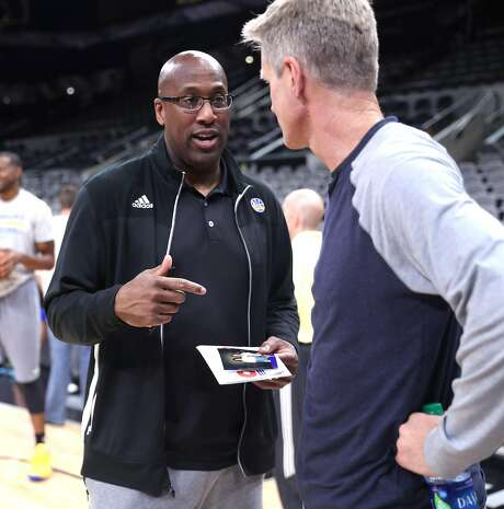Acting head coach Mike Brown (left) chats with head coach Steve Kerr in San Antonio after practice Sunday. Brown said Kerr's input is still vital to the team's success. Photo: Scott Strazzante, The Chronicle