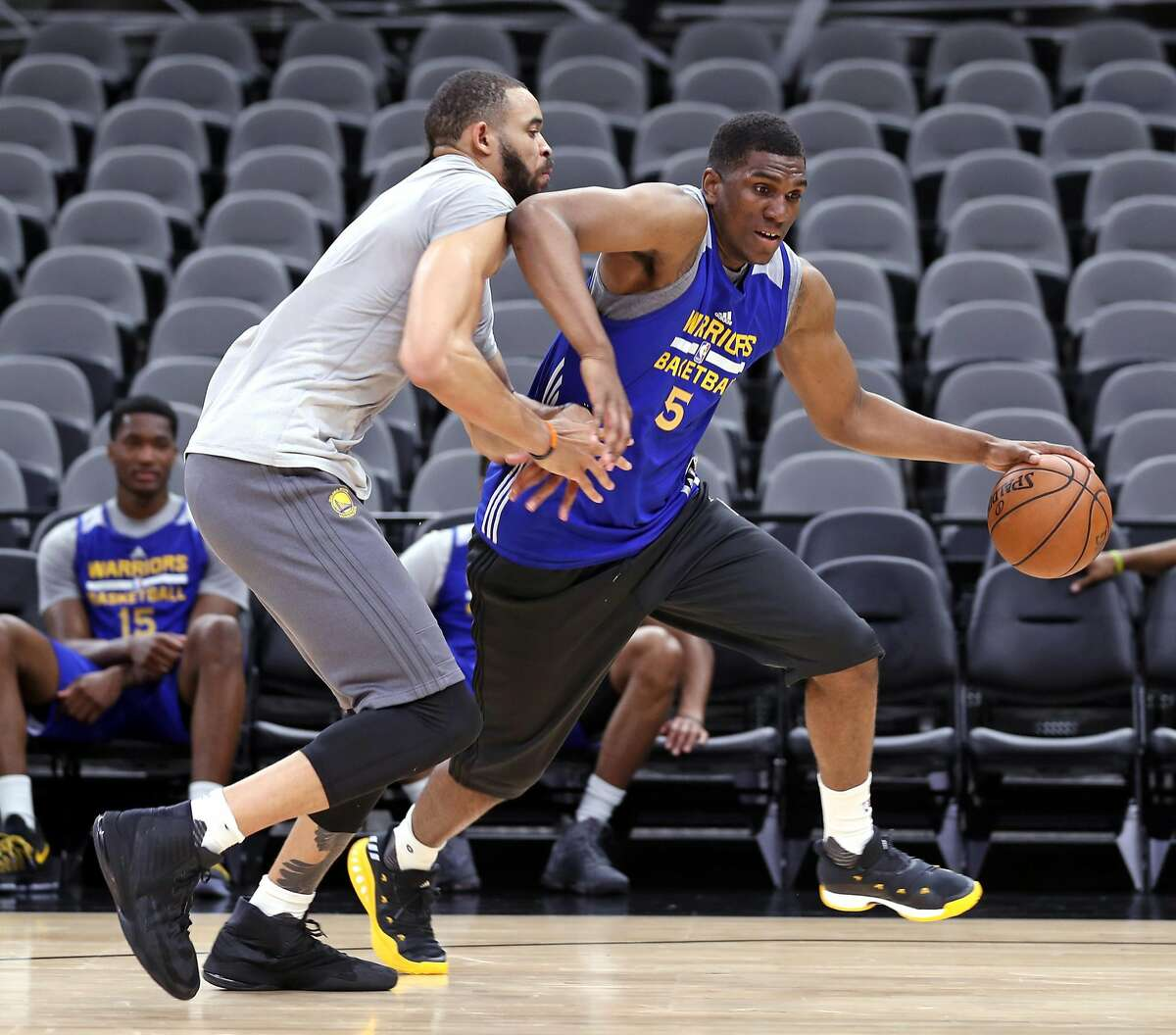 Golden State Warriors' Kevon Looney and JaVale McGee after practice during NBA Western Conference Finals at AT&T Center in San Antonio, Texas, on Sunday, May 21, 2017.