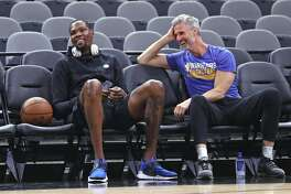 Golden State Warriors' Kevin Durant and assistant coach Bruce Fraser after practice during NBA Western Conference Finals at AT&T Center in San Antonio, Texas, on Sunday, May 21, 2017.
