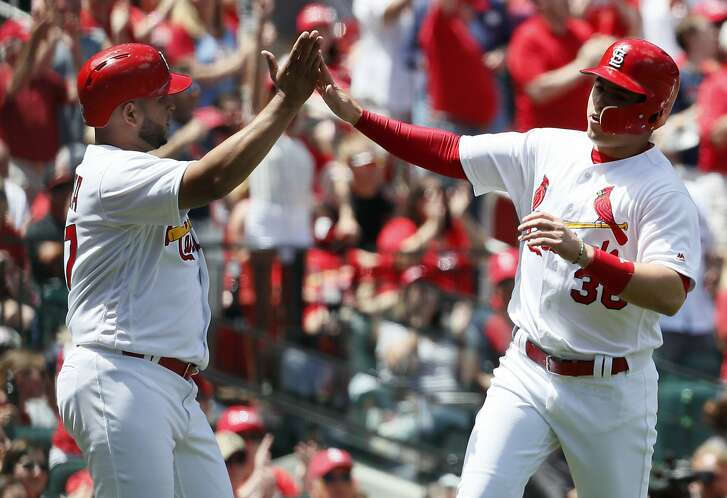 St. Louis Cardinals' Aledmys Diaz, right, and teammate Jhonny Peralta celebrate after scoring during the second inning of a baseball game against the San Francisco Giants, Sunday, May 21, 2017, in St. Louis. (AP Photo/Jeff Roberson)