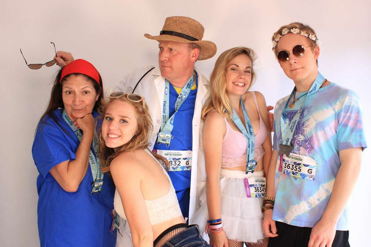 Bay to Breakers 2017 runners pose for pictures at the SFGATE finish line booth on Sunday, May 21, 2017. Photo booth images courtesy ofKande Photo Booths.