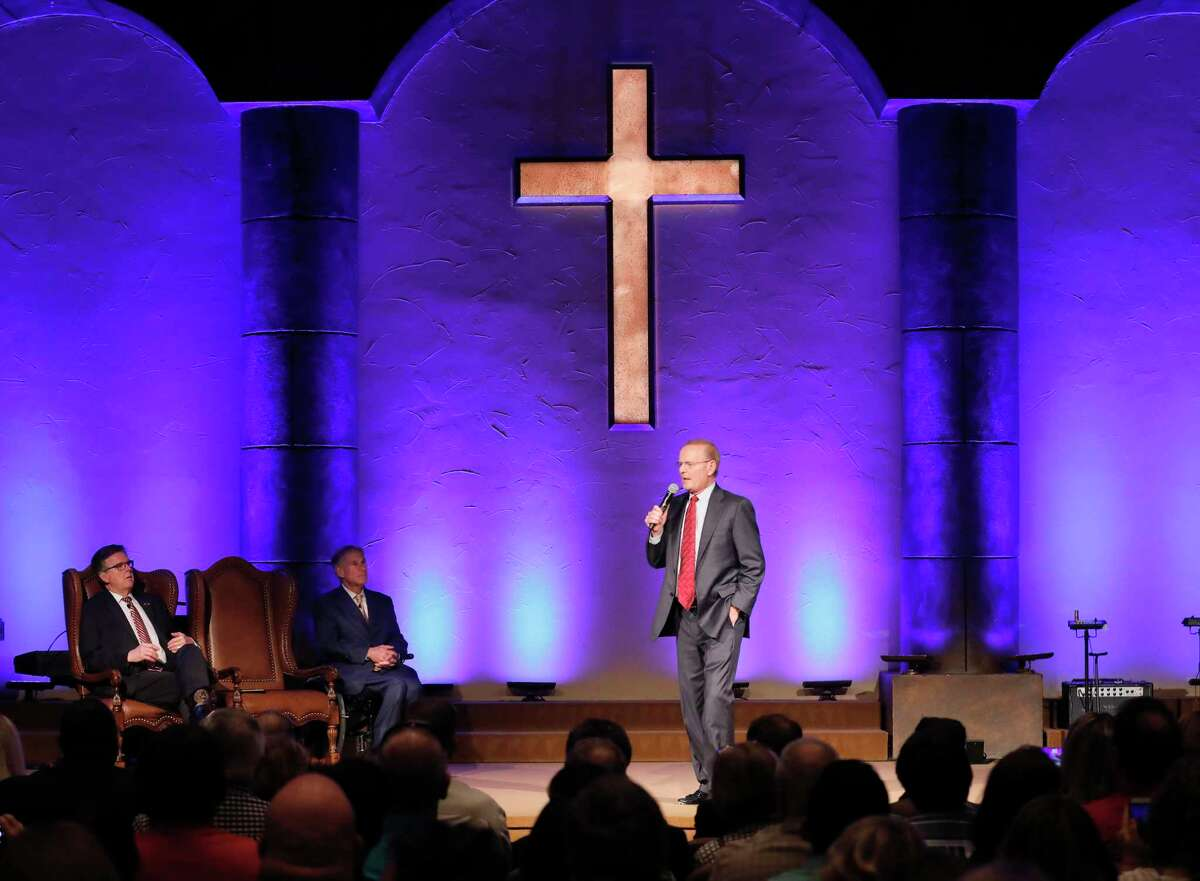 Grace Church senior pastor Dr. Steve Riggle speaks to the congregation as Governor Greg Abbott (center) and Lt. Governor Dan Patrick (left) attend the SB 24 signing ceremony during the 11:00 am worship service at Grace Church, The Woodlands on Sunday, May 21, 2017.
