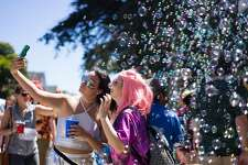 Participants take a selfie during the annual Bay to Breakers race in San Francisco, Calif. on Sunday, May 20, 2017. More than 70,000 people participated in the race.