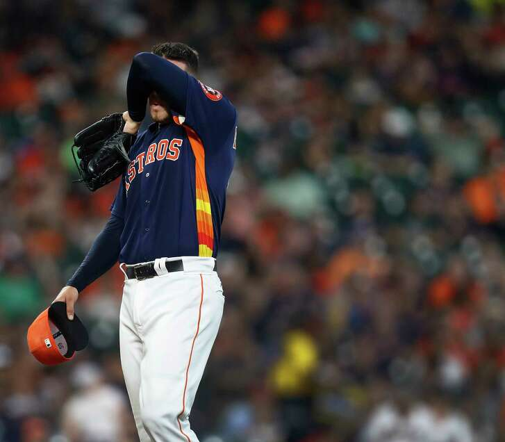 Houston Astros starting pitcher Joe Musgrove (59) wipes his brow as manager A.J. Hinch walked out to the mound to retrieve him during the fourth inning of an MLB baseball game at Minute Maid Park, Sunday, May 21, 2017.