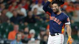 Houston Astros second baseman Jose Altuve (27) reacts after striking out during the first inning of an MLB baseball game at Minute Maid Park, Sunday, May 21, 2017.