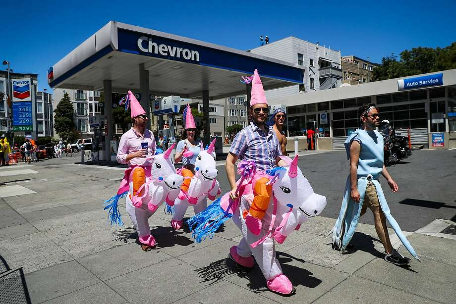 People dressed as unicorns walk on Fell Street as they participate in the Bay to Breakers annual race in San Francisco, California, on Sunday, May 21,2017. Photo: Gabrielle Lurie, The Chronicle