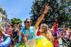 Remi Fernandez laughed as he played with bubbles on Fell Street during the Bay to Breakers annual race in San Francisco, California, on Sunday, May 21,2017.