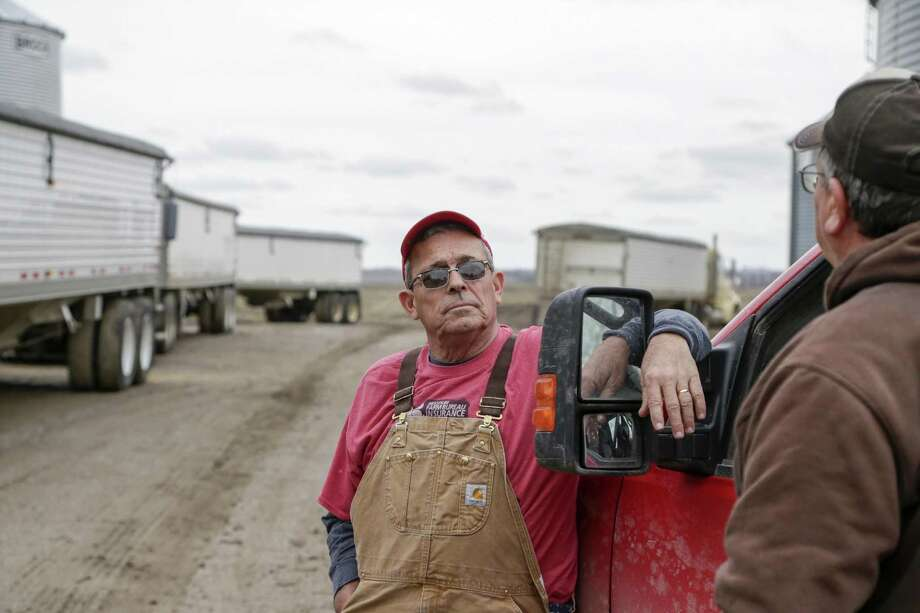 Blake Hurst, a corn and soybean farmer and president of the Missouri Farm Bureau, (left) talks with his brother Kevin Hurst on his farm in Westboro, Missouri. President Donald Trump has vowed to redo the North American Free Trade Agreement, but NAFTA has widened access to Mexican and Canadian markets, boosting U.S. farm exports and benefiting many farmers. Hurst says NAFTA has been good for his business and worries that he'll lose out in a renegotiation. Photo: Nati Harnik /Associated Press / Copyright 2017 The Associated Press. All rights reserved.