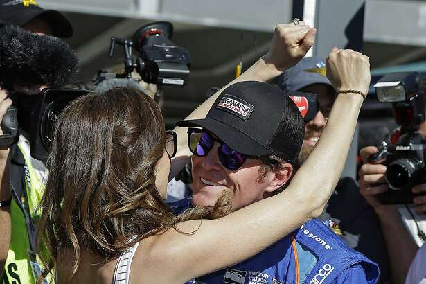 Scott Dixon, right, of New Zealand, celebrates with his wife Emma after winning the pole during qualifications for the Indianapolis 500 IndyCar auto race at Indianapolis Motor Speedway, Sunday, May 21, 2017, in Indianapolis. (AP Photo/Michael Conroy)