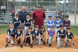 Deer Park's newly-named 8-and-under All-Stars and the coaching staff pose for a group picture following ceremonies at the Ruth Minchen Athletic Complex last week.  The team immediately began practice the following night, preparing for their first tournament action early next month.