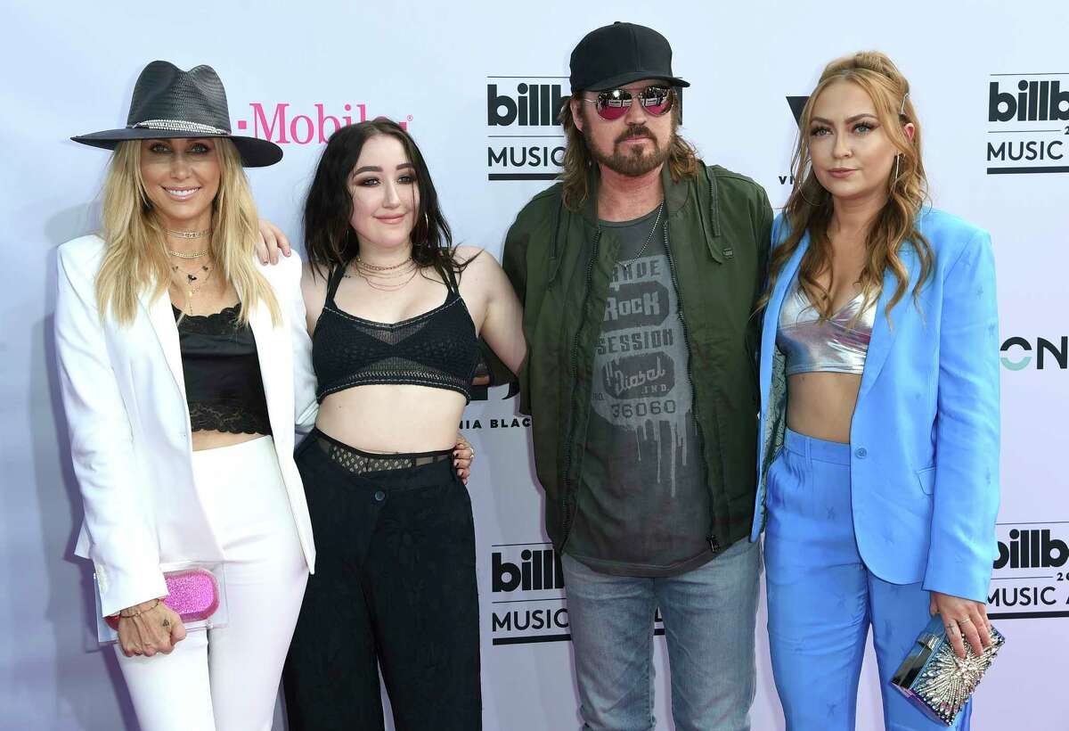 Tish Cyrus, from left, Noah Cyrus, Billy Ray Cyrus and Brandi Glenn Cyrus arrive at the Billboard Music Awards at the T-Mobile Arena on Sunday, May 21, 2017, in Las Vegas. (Photo by Richard Shotwell/Invision/AP)