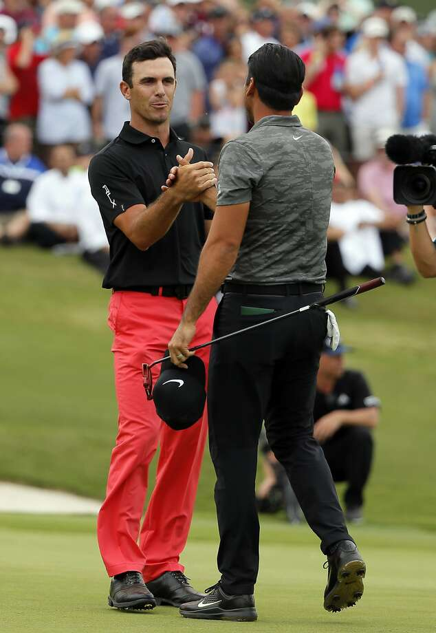 Billy Horschel (left) shakes hands with Jason Day. Photo: Tony Gutierrez, Associated Press