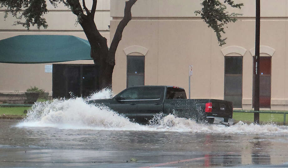 A motorist drives through a flooded intersection at Hillside Road and Springfield Avenue as a severe storm swept through the area Sunday, May 21, 2017. The storm brought heavy rain, hail and strong wind gusts. Photo: Cuate Santos/Laredo Morning Times