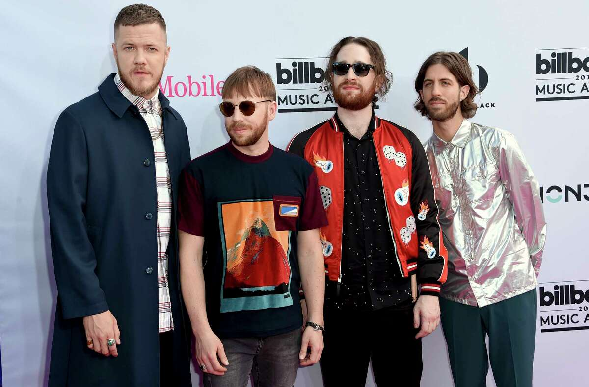 Dan Reynolds, from left, Ben McKee, Daniel Platzman and Daniel Wayne Sermon, of Imagine Dragons, arrive at the Billboard Music Awards at the T-Mobile Arena on Sunday, May 21, 2017, in Las Vegas.