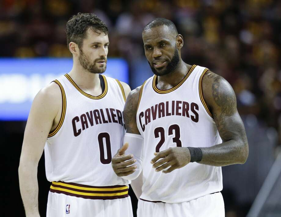 Cleveland Cavaliers' LeBron James (23) talks with Kevin Love (0) against the Boston Celtics during the second half of Game 3 of the NBA basketball Eastern Conference finals, Sunday, May 21, 2017, in Cleveland. The Celtics won 111-108. (AP Photo/Tony Dejak) Photo: Tony Dejak/Associated Press