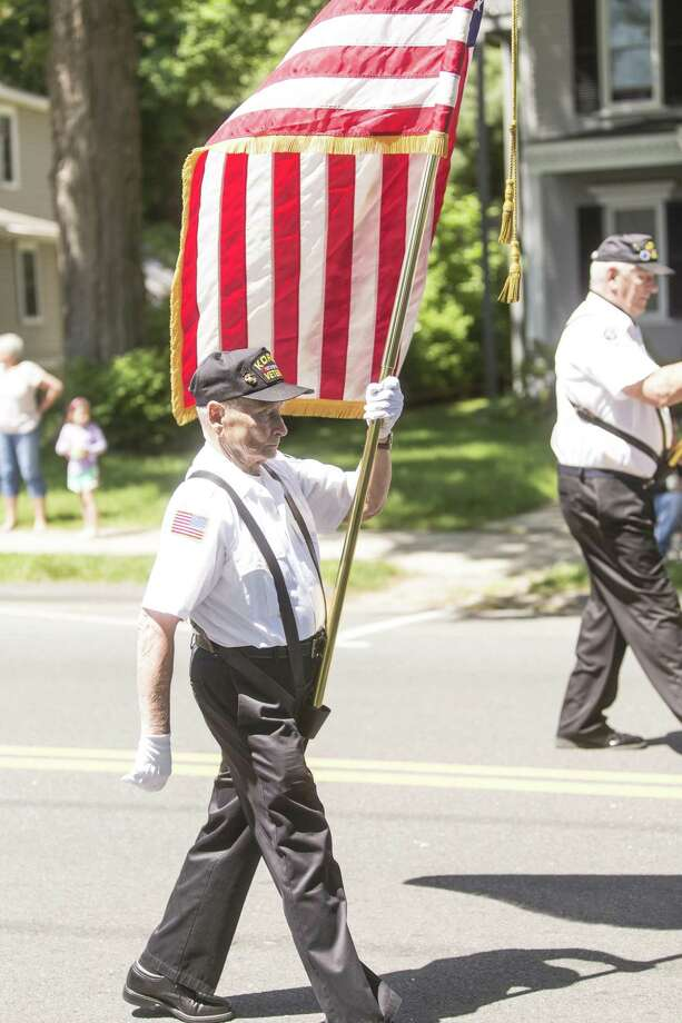 Korean War Veteran Howard Klump marches during the Bethel Memorial Day Parade in Bethel, Conn. on Sunday, May 21. Photo: Christopher Burns / For Hearst Connecticut Media / The News-Times Freelance