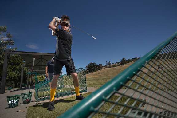 Tony Tomarchio sports bright socks and an untraditional golf form in his 2nd year as a member of the Mediocre Golf Association on Sunday, May 21, 2017 in Walnut Creek, Calif.