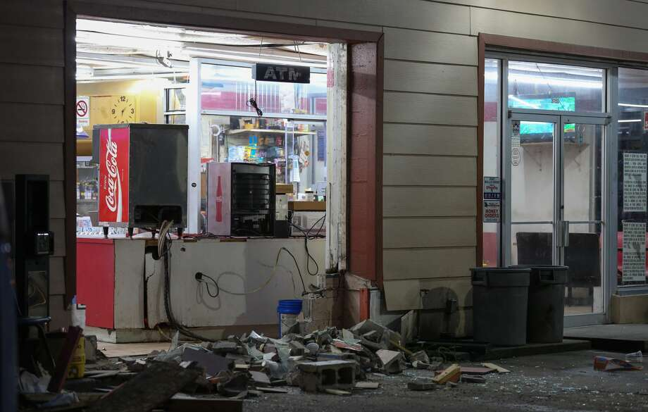 Suspects backed a cargo van into a convenience store and stole an ATM machine in the 3100 block of Produce Row near Old Spanish Trail in Houston, Texas on May 22, 2017, in Houston. Photo: Godofredo A. Vasquez/Houston Chronicle