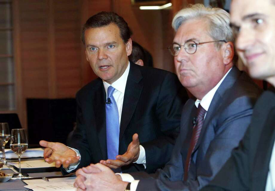 Huntsman President and CEO Peter R. Huntsman, left,. and Hariolf Kottmann, CEO of Clariant, announce the merger of their companies Monday in Zurich. Photo: Siggi Bucher, Associated Press / Keystone