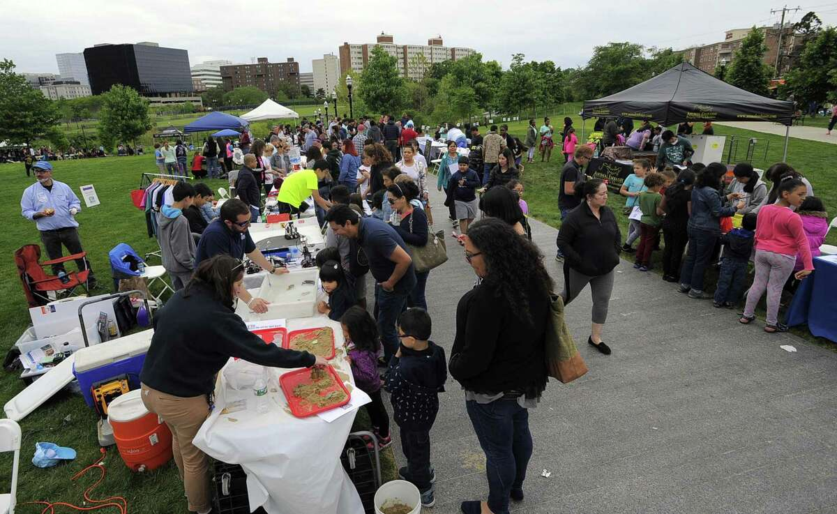 Families check out various stations of crafts and experiments during the fourth annual STEMFest at Mill River Park in Stamford, Conn. on May 20, 2017. The free, day-long festival by Stamford Public Schools, featured hands-on science, technology, engineering and math activities for all ages.