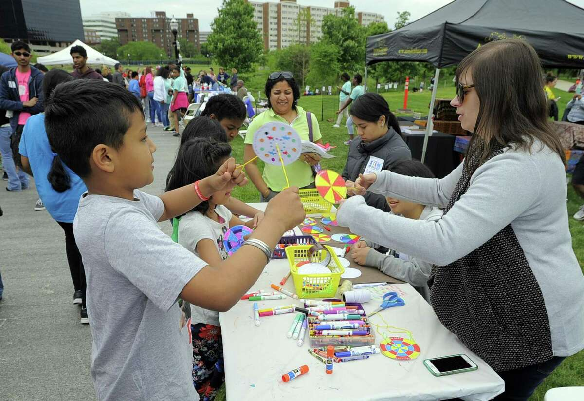 A young boy plays with a spinning wheel during the fourth annual STEMFest at Mill River Park in Stamford, Conn. on May 20, 2017. The free, day-long festival by Stamford Public Schools, featured hands-on science, technology, engineering and math activities for all ages.