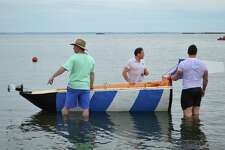 "Pilots of the Lighthouse boat test its sea-worthiness, including, from left, John Strot and Jeff Bates of Darien, and Chris Fendt of Queens, N.Y., at the ""For Michael Taylor"" fundraiser event at Weed Beach, on behalf of the nonprofit Shatterproof, Saturday, May 20, 2017, in Darien, Conn."