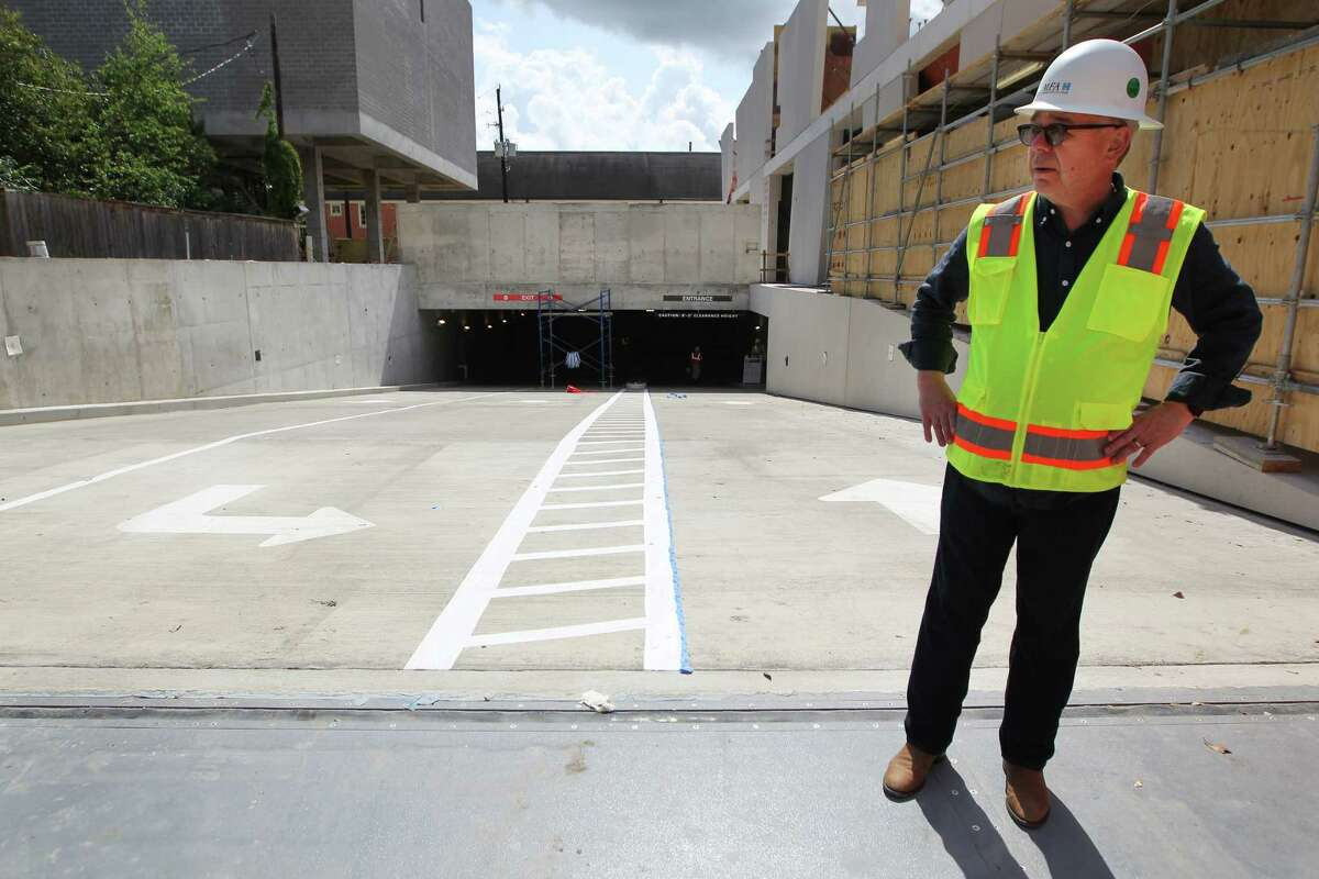 Willard Holmes, the chief operating officer of the Museum of Fine Arts, Houston, stands atop the new parking garage at 5101 Montrose. Near his feet is a flood gate that responds to water pressure.