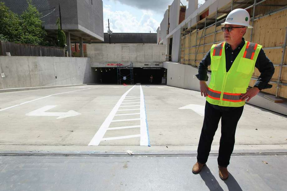 Willard Holmes, the chief operating officer of the Museum of Fine Arts, Houston, stands atop the new parking garage at 5101 Montrose. Near his feet is a flood gate that responds to water pressure. Photo: Steve Gonzales, Staff / © 2017 Houston Chronicle
