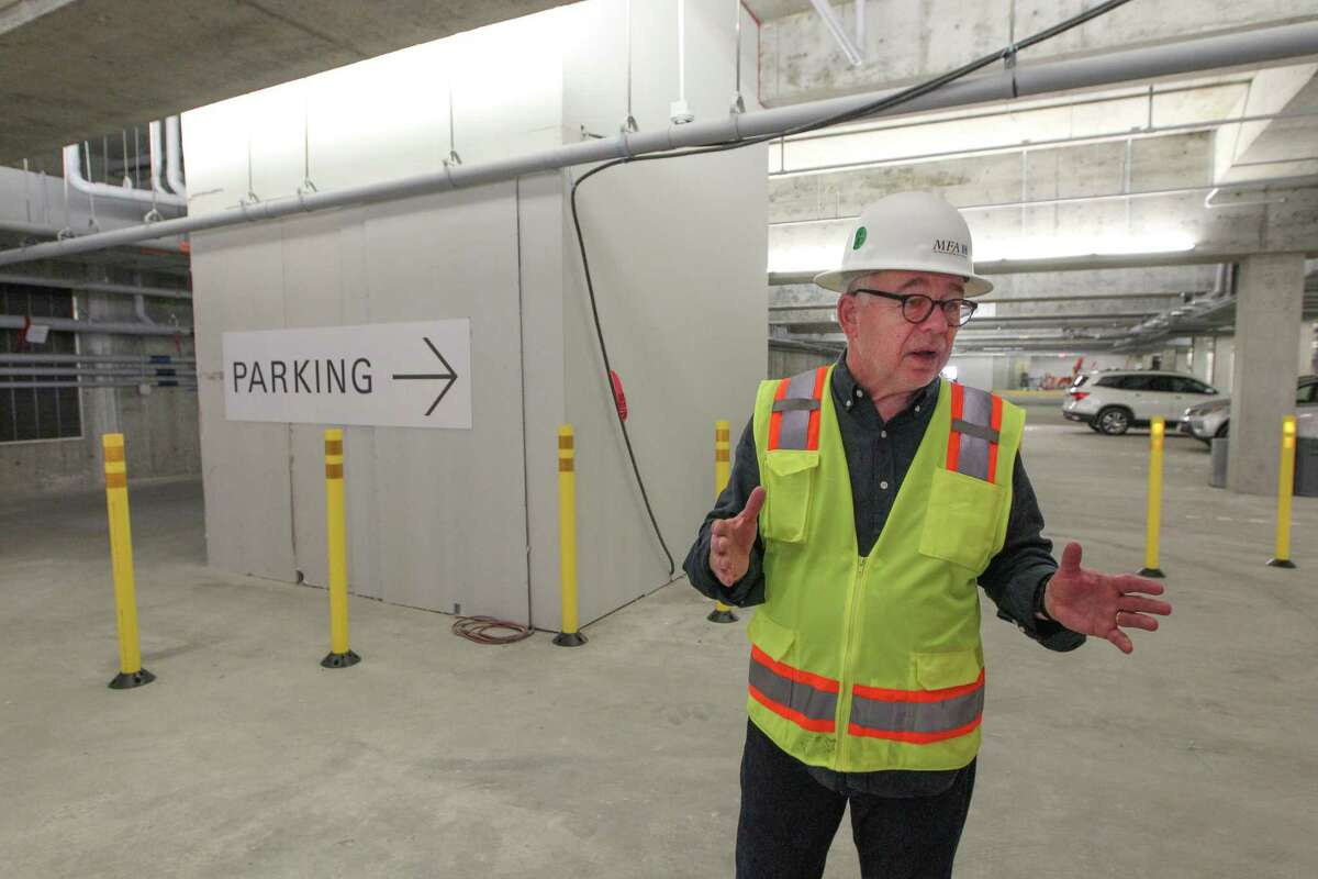 Willard Holmes stands in the new MFAH parking garage near a 'closet' that contains a crane being used for the construction of the Glassell School of Art building above.