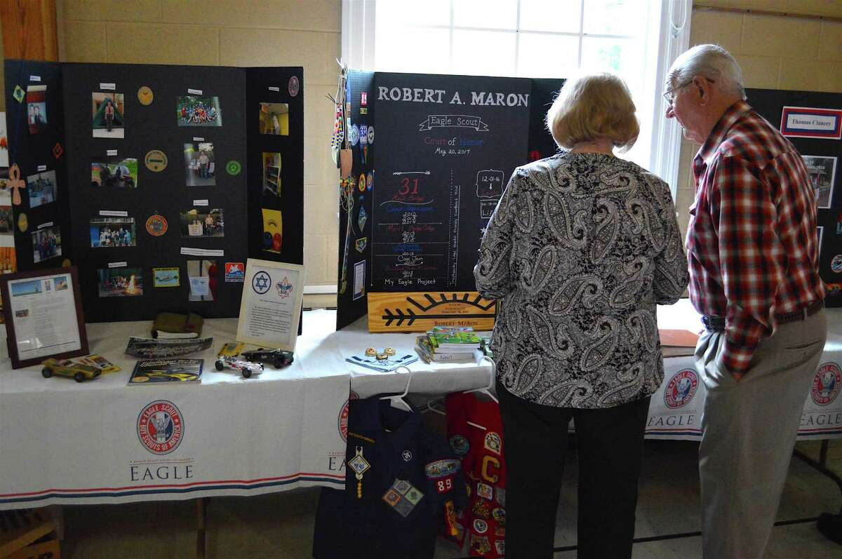 James and Dawn Holodak of Yonkers, N.Y., check out the project displays at the BSA Troop 10 Eagle Court of Honor, Saturday, May 20, 2017, at First Presbyterian Church in Fairfield, Conn.