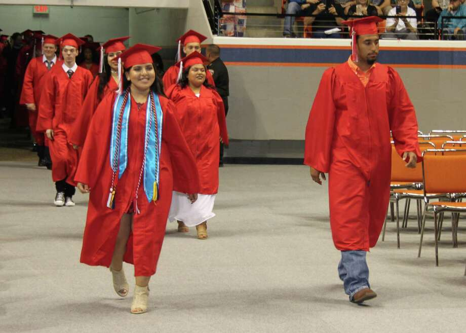 Cleveland High School graduates of the Class of 2017 make their way into the Bernard G. Johnson Coliseum in Huntsville at the start of the ceremony. Photo: Jacob McAdams