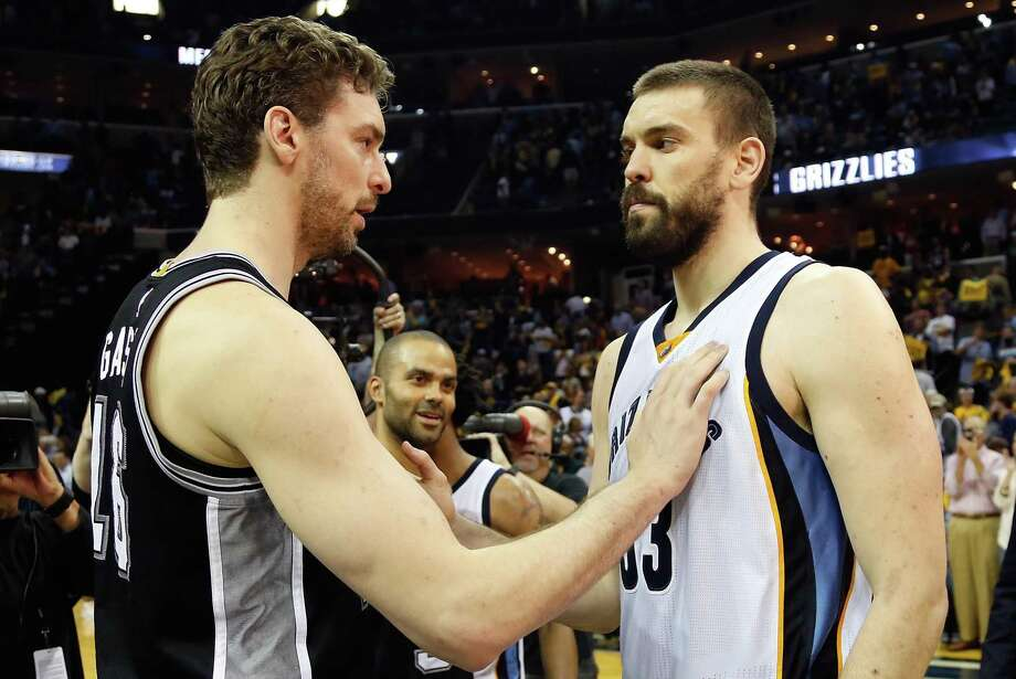 Pau and Marc Gasol greet each other after the Spurs won Game 6 on April 27. Photo: Frederick Breedon /Getty Images / 2017 Getty Images