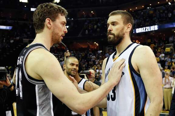 Pau and Marc Gasol greet each other after the Spurs won Game 6 on April 27.