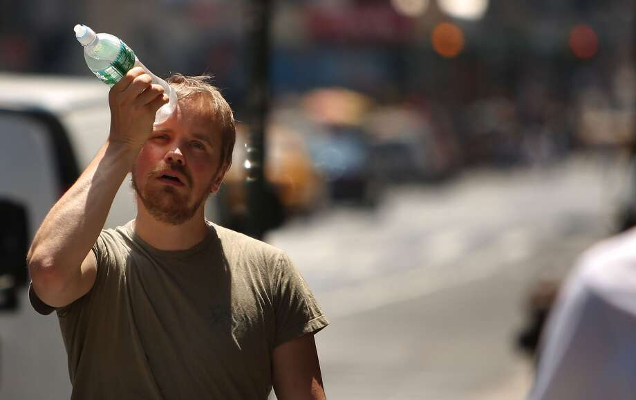 Summer heat makes it more challenging to regulate blood pressure, which can lead to fainting. Photo: Spencer Platt / Getty Images