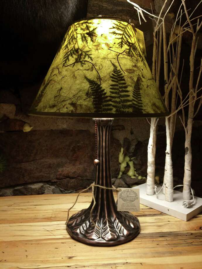 Lampshade by Northeast Living Lights created with ferns and cedar leaves picked locally. Available at Hudson River Trading Co., 292 Main St., North Creek. Shade: $92 Base by Meyda Lighting: $125