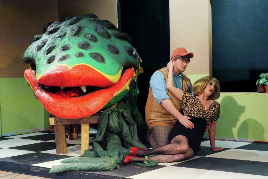 "Nick Thomas as Seymour and Whitney Wyatt as Audrey rehearse a scene from ""Little Shop of Horrors"" at Clear Creek Community Theater. Photo: Kirk Sides / © 2017 Kirk Sides / Houston Chronicle"