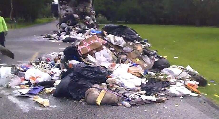 A load of trash had to be dumped onto Oak Drive after it ignited in a garbage truck.Click to see a list of items that are not allowed in your trash. Photo: Steven Simmons