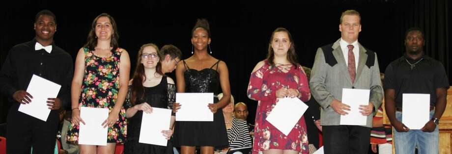 The recipients of the Amber Grace Basye Fly High scholarship, left to right: De'Ondre Blanks, Emily Ruesewald, Lindsey Landrum, Migaria Brandley, Katelynn Johnson, Deaven Fussell and Don Taylor. Photo: Jacob McAdams