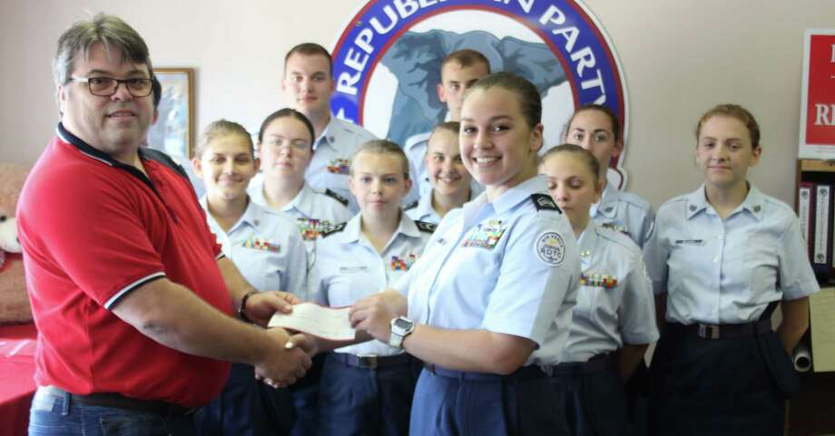 San Jacinto County Republican Club Chairman Dwayne Wright (left) presents Coldspring-Oakhurst CISD Air Force JROTC Cadet Lieutenant Colonel Sara Coe (right) with a donation of $1,000 to the organization on May 19. The donation is awarded due to the cadets volunteering to help the Republican Club with last month's Reagan Dinner. Photo: Jacob McAdams