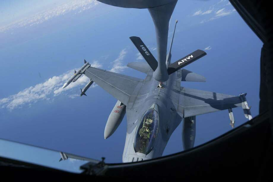 U.S. Air Force Staff Sgt. Nick Moore, with the 186th Air Refueling Wing, operates the boom on the back of a KC-135 Stratotanker while refueling an F-16 from the 138th Fighter Wing over the Gulf of Mexico, Wednesday, Feb. 1, 2017, in Houston. ( Mark Mulligan / Houston Chronicle ) Photo: Mark Mulligan, Staff / Houston Chronicle / © 2017 Houston Chronicle