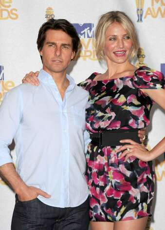 UNIVERSAL CITY, CA - JUNE 06:  Actor Tom Cruise and actress Cameron Diaz pose in the press room at the 2010 MTV Movie Awards at Gibson Amphitheatre on June 6, 2010 in Universal City, California.  (Photo by Jason Merritt/Getty Images) *** Local Caption *** Tom Cruise;Cameron Diaz Photo: Jason Merritt, Getty Images / 2010 Getty Images