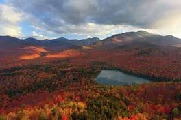 Chris Tennant?s ?Last Light,? taken from the summit of Mount Jo overlooking Heart Lake in Lake Placid