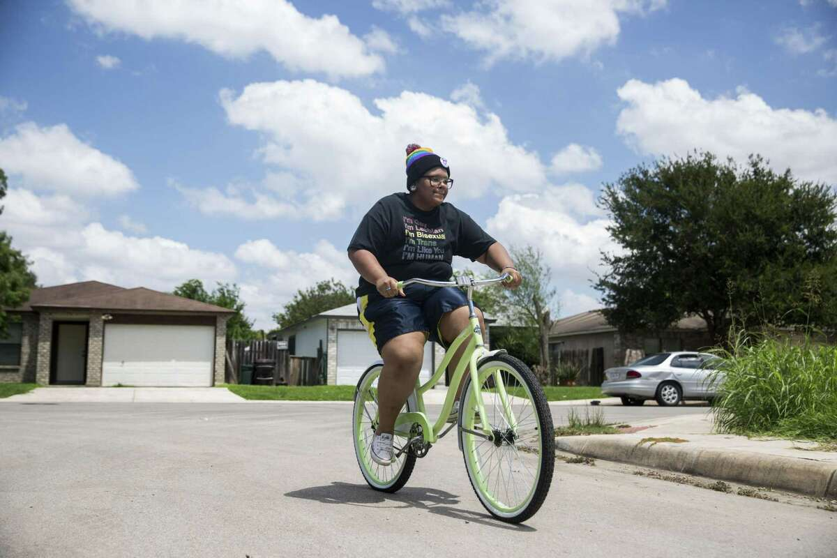 Adam Snow, who is transgender, rides his bike in San Antonio, Texas on August 24, 2017. He was told that, before he will be allowed to take testosterone, he must lose some weight , so he started riding his bike regularly.