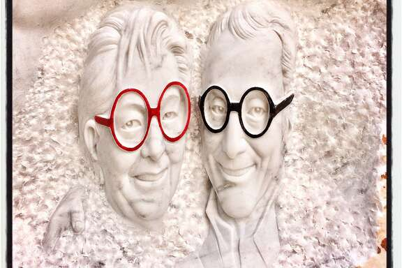 Yvonne Sangiacomo and her late husband, developer Angelo Sangiacomo, memorialized in a stone carving at Piazza Angelo. May 18, 2017.