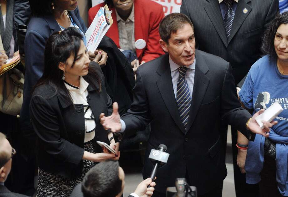 Senator Diane Savino, left, and Senator Jeff Klein take part in a rally held by public housing residents and advocates for public housing on the steps of the Million Dollar Staircase on Monday, March 16, 2015, in Albany, N.Y.  (Paul Buckowski / Times Union)