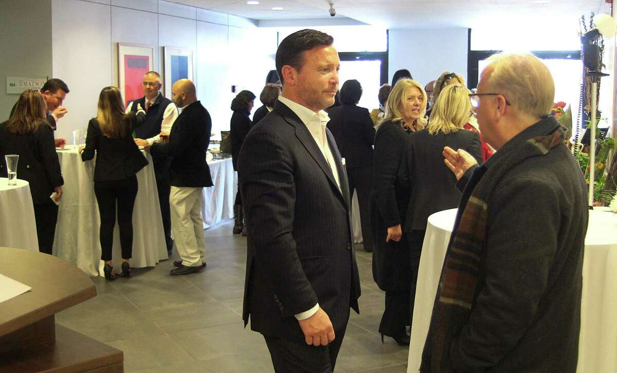 Maplewood Senior Living CEO Greg Smith talks in March 2017 with Danbury, Conn. Mayor Mark Boughton, during the opening of the new Maplewood At Home office in Danbury.
