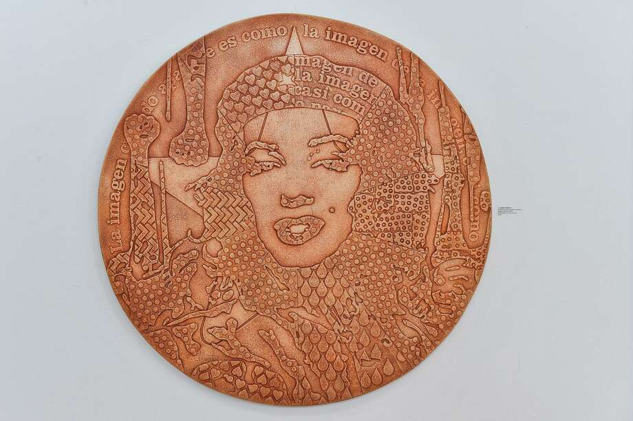 """One of the pieces from the exhibit of Cuban artist Adrian Rumbaut from the series """" Symbols, Supports, and Steps"""" depicts his mash-up of Marilyn Monroe and Che Guevara. Photo: Robin Jerstad /San Antonio Express News / ROBERT JERSTAD"""