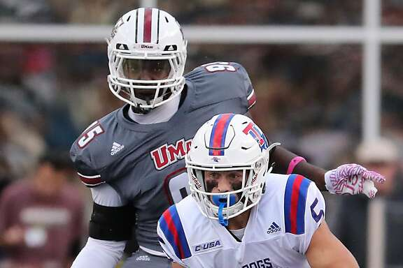FILE - In this Oct. 15, 2016 file photo, Massachusetts' Kyle Horn cannot catch Louisiana Tech receiver Trent Taylor during the first half of an NCAA college football game Saturday, Oct. 15, 2016, in Foxborough, Mass. The 5-foot-8 Taylor is the nation�s leading active receivers with 315 catches for 3,946 yards and 30 TDs in his career.  Louisiana Tech will play Navy on Friday, Dec. 23.  (Matthew J. Lee /The Boston Globe via AP, File)