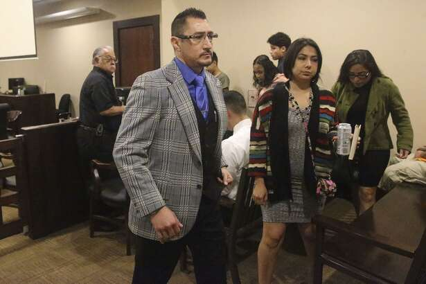 Richard Luis Amezquita (center) leaves court Monday May 22, 2017 at the 186th State District Court. Amezquita, a door-to-door salesman, shot and killed a man he said attacked him after Amezquita tried to sell him a home security system. Amezquita was arrested and charged with murder November 7, 2015 in the fatal shooting of Kerry O'Toole,53. The jury in Amezquita's case began deliberations Monday May 22, 2017.